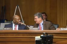 Senators' Manchin and Scott exchange ideas.