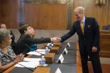 Chairman Nelson greets witnesses prior to the start of a hearing.