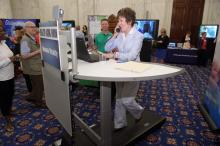 Ranking Member Susan M. Collins demonstrates some of the new technology being presented at the Committee's Healthy Aging Forum.